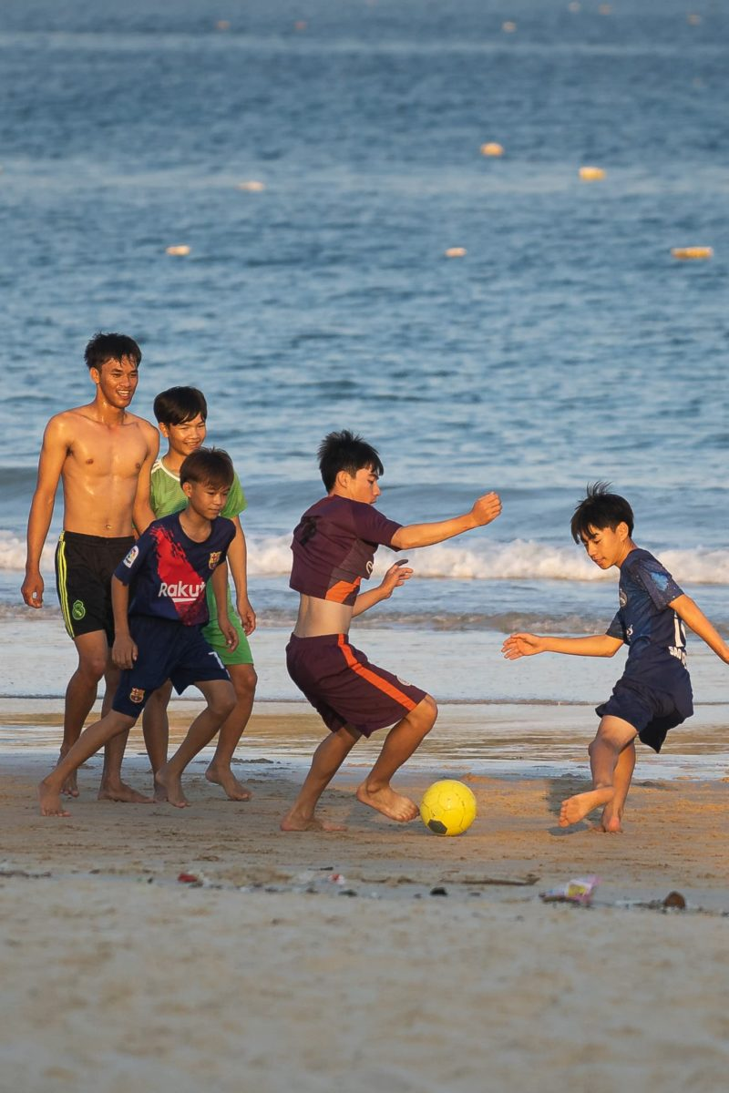 vietnamese boys playing soccer